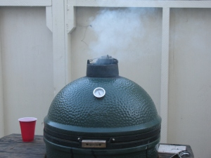 Getting the Big Green Egg up to temperature (250 degrees F). Hickory chips were added.