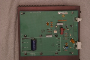 Figure 3. The DC-DC supply board. A 24V to 12V brick converter is mounted to a 14-1/4 inch by 7-1/4 inch heatsink under the PCB. The existing DC-DC converter may possibly be modified to make the unit work on 12VDC input. See text.