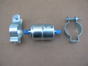 Electrical conduit clips are used to mount the first fuel filter to the chassis