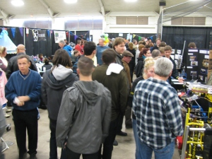 Despite the rain, there was a constant crush of people in, near and around the Not Your Grandpa's Ham Radio booth at the 2013 San Diego Mini Maker Faire