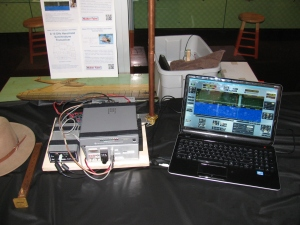 "Dennis brought his 10 GHz / 24 GHz dual band station with software defined radio and notebook computer. The ""waterfall"" display is used to visually indicate very weak to very strong signals across the receive band. The digital signal processing in this system can improve signal reception"