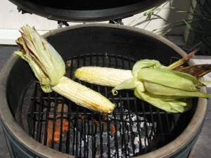 Peel the husks down if you want, and roast the kernels directly. This will add some nice grill marks to your corn